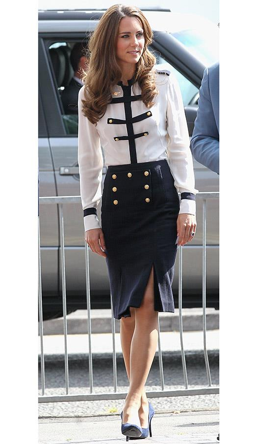 In a military-inspired white shirt and pencil skirt at Summerfield Community Centre, on August 19, 2011 in Birmingham, England.