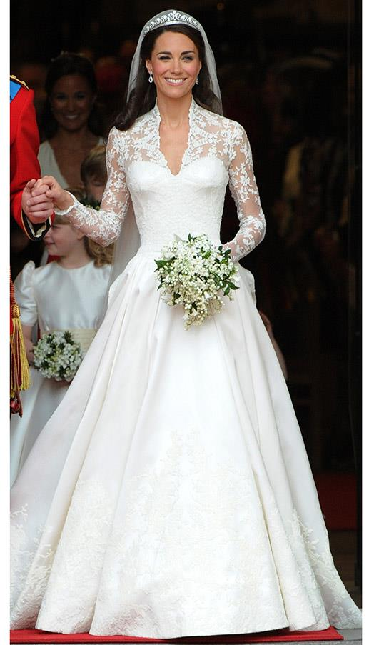 In the iconic lace and satin wedding dress, custom designed by Sarah Burton, at Middleton's royal nuptials to Prince William, on April 29, 2011 in London.