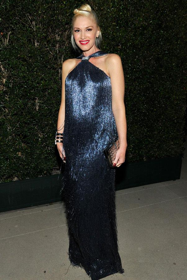 Sporting her signature red lip, Stefani dazzled in a subtle navy which highlighted her growing bump.