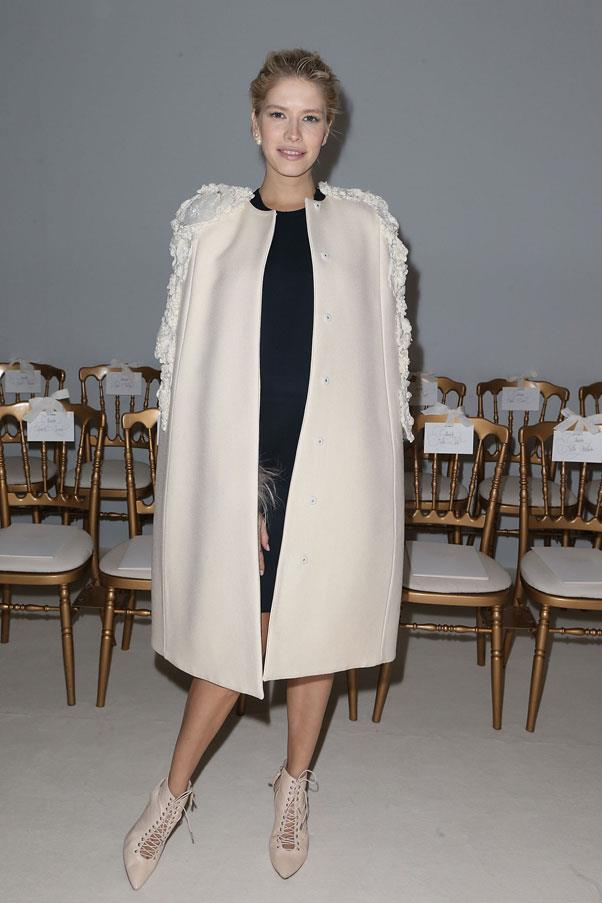 <strong>Elena Perminova</strong> <br>You may not be able to fit into some of your clothes while pregnant - which is where oversized items like boxy coats will become your saving grace.