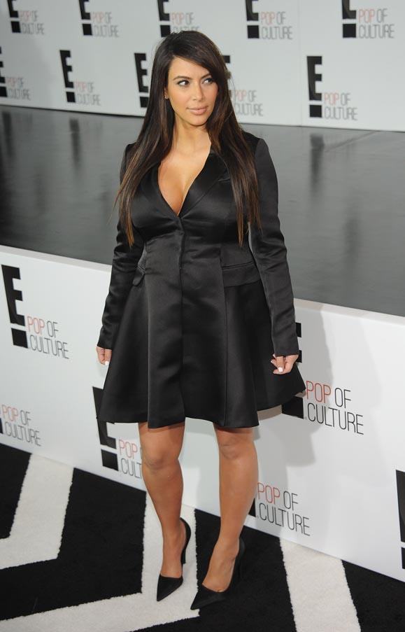 <strong>Kim Kardashian</strong> <br>A low cut neckline keeps the curvaceous Kardashian from being swamped by her dress.