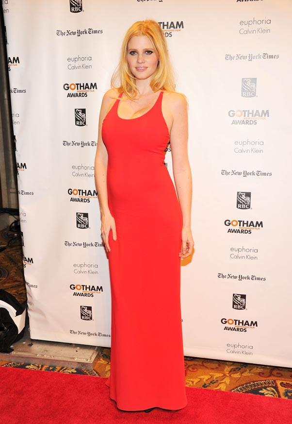 <strong>Lara Stone</strong> <br>The British supermodel looks red hot in a low cut column dress.