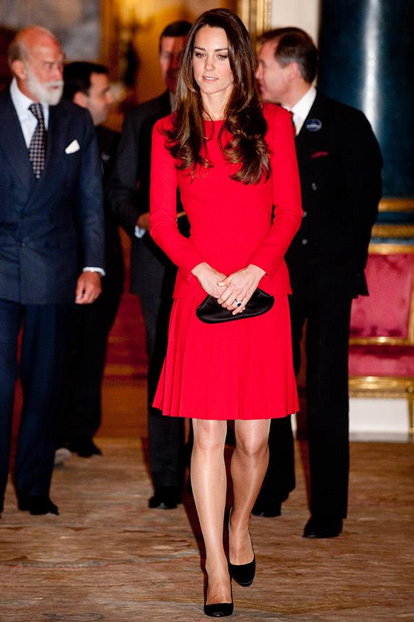 The Duchess steps out at the Dramatic Arts reception at Buckingham Palace on February 17, 2014. Kate wears an Alexander McQueen number first worn by the brunette beauty in 2012.