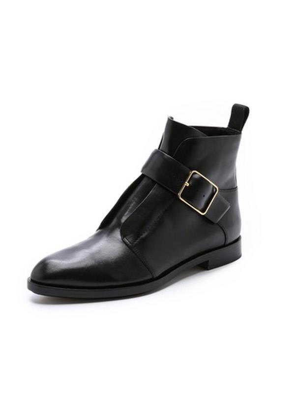 """<b>Flat boots</b><br> The uniform of every It girl who's worth her weight in Glastonbury and Coachella tickets, the heel-less or low-heel black boot is a must buy for all occasions. Just remember to shop some boot polish while you're at it, as you'll be wearing these ones down. <br> <i>Shop: Alexander Wang Lena Monk Strap Booties; <a href=""""http://www.shopbop.com/lena-monk-strap-bootie-alexander/vp/v=1/1502630004.htm?folderID=2534374302162831&fm=other-shopbysize-viewall&colorId=12867"""">shopbop.com</a></i>"""