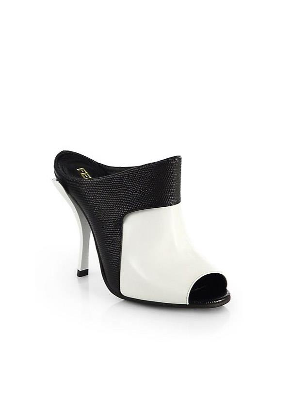 """<strong>On trend style</strong><br> Because a girl has got to indulge in at least one trend piece a season… This year, the shoe de jour to slip into is the mule. From spikey heels to sturdy wedges and everything in between, this on-point style packs an on-point punch.<br> <i>Shop: Fendi Jungle Bicolor Patent Leather Mules; <a href=""""http://www.saksfifthavenue.com/main/ProductDetail.jsp?PRODUCT%3C%3Eprd_id=845524446658213&R=8053679763341&P_name=Fendi&sid=1442777D97B4&Ntt=fendi+shoes&N=0&bmUID=kgCqPMF"""">saks.com</a></i>"""