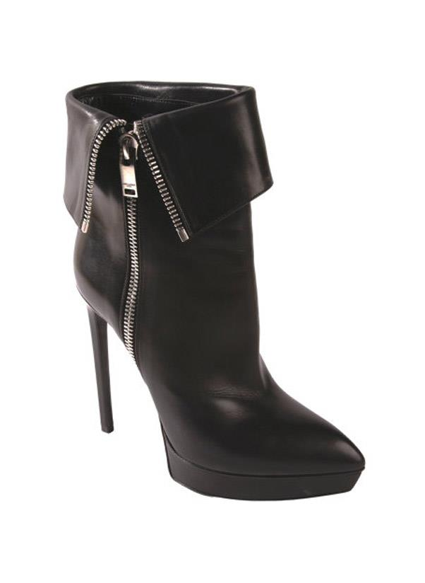 """<strong>High heel booties</strong><br> Whether they're cut to the ankle, above the knee or heading up towards the thigh, a pair of high-heel boots are a must have for your autumn/winter wardrobe. For an on-trend style opt for a pointy toe or if you're after a classic shop a round-toe. <br> <i>Shop: Saint Laurent Zip Ankle Boot; <a href="""" http://www.barneys.com/on/demandware.store/Sites-BNY-Site/default/Product-Show?pid=502767353&cgid=womens-boots&index=21"""">barneys.com</a></i>"""