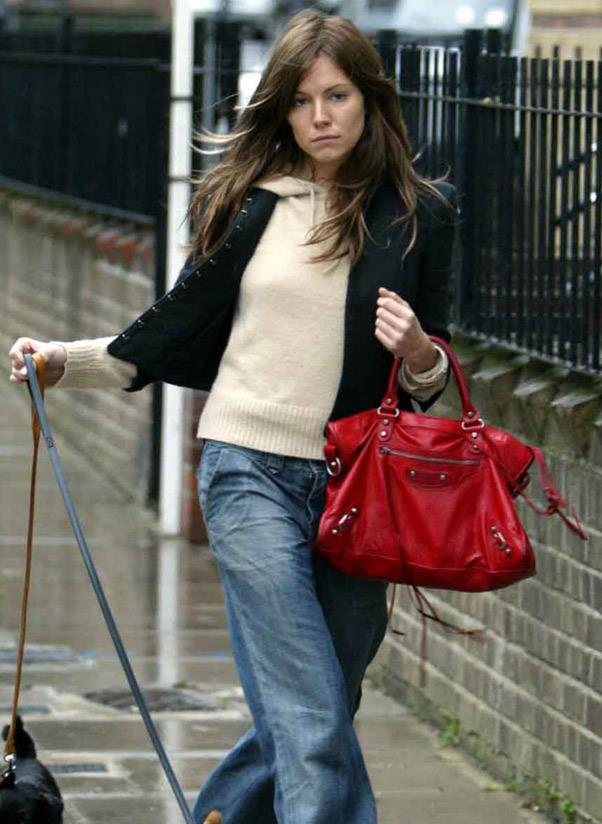 <b>Balenciaga Motorcycle</b><br> Remember when Sienna Miller had brown hair? We digress… the Balenciaga Motorcycle bag is a classic carryall with a punk-rock edge. Adorning the arms of It girls and models since 2001. <br> <i>Sienna Miller (2004)</i>