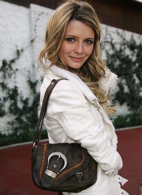 <strong>Dior Saddle </strong><br> John Galliano introduced the Dior Saddle bag in 1999 and it went on to become a global best seller. By 2003 as many as 125 versions of the purse existed, from crocodile skin to casual denim. <br> <i>Mischa Barton (2006)</i>