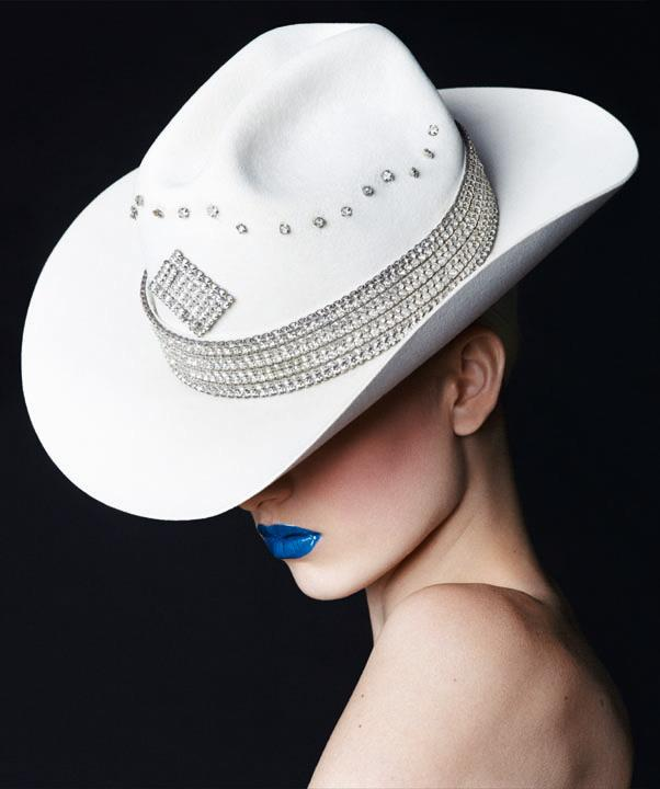 In <em>Early Halloween</em> hat. <br><br>A daring swipe of color electrifies lips and lids. For a rich cobalt mouth, dab on <em>M.A.C. Lipmix</em> in Blue.
