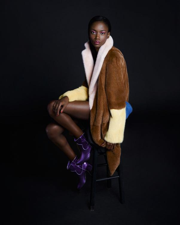 <strong>Riley Montana</strong> in <em>Céline </em>coat and <em>Gianvito Rossi</em> boots.