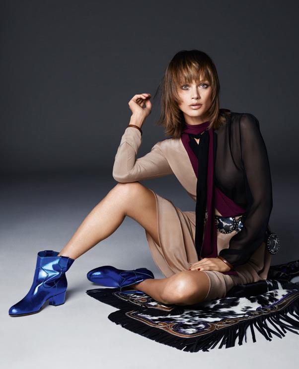 In <em>Prada </em>dress and blouse; <em>Early Halloween</em> belt; <em>Gianvito Rossi </em>boots.