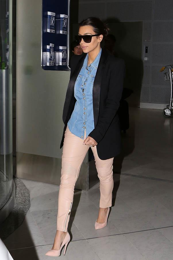 In gorgeous peach leather trousers and a denim shirt, arriving at the airport on May 1, 2014 in Paris, France.