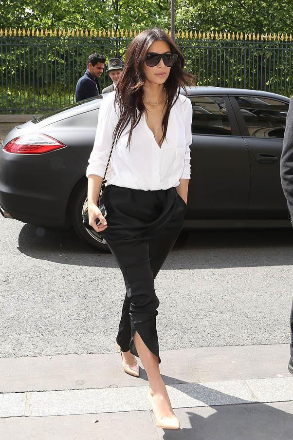 Could Kardashian look any more chic? In a tailored pair of black trousers and crisp white shirt, in Paris on April 30, 2014.