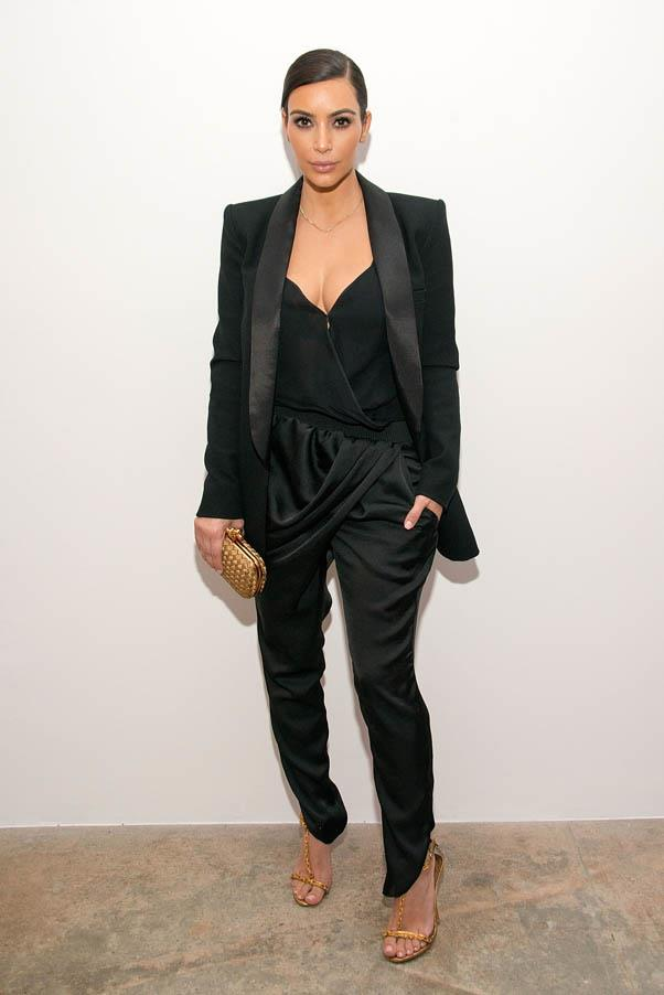 Kardashian sharpens up her jumpsuit's draped silhouette with a sharp blazer and gold accessories at the Congressional candidate Marianne Williamson press event on April 8, 2014.