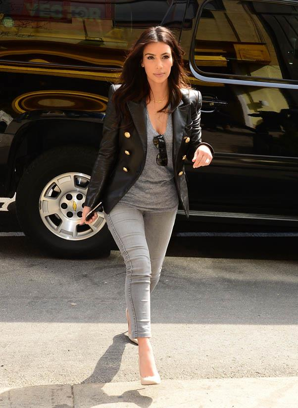 "In Kardashian's new ""uniform"" - cropped jeans, slouchy tee, sharp blazer and nude pumps - on March 25, 2014."