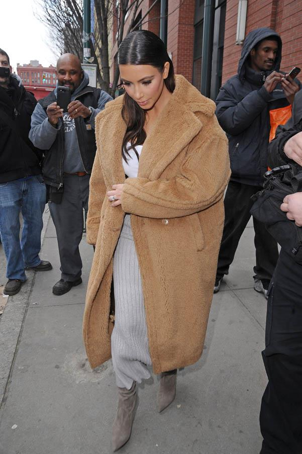 In a Max Mara oversized camel coat on February 25, 2014.