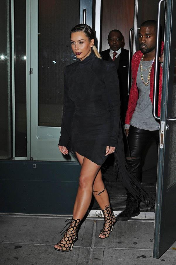 In thigh-baring fringe while out in New York with Kanye West on November 23, 2013.