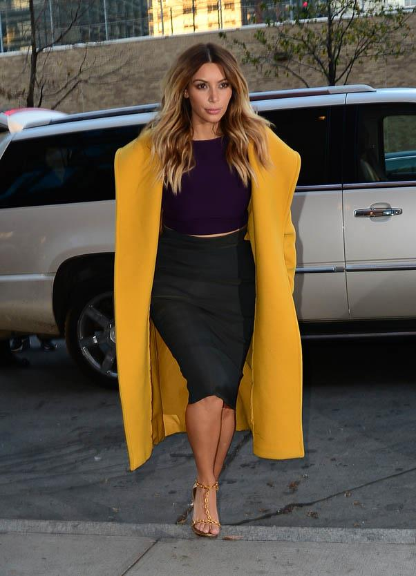 Wearing her canary-yellow Max Mara coat again while out in New York on November 20, 2013, this time colour-blocking it with purple and green.