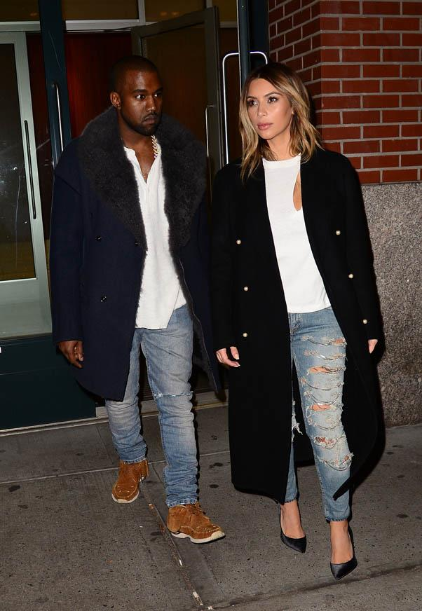 Ripped jeans and peekaboo cutouts add edge to this outfit, worn out in New York with Kanye West on November 20, 2013.