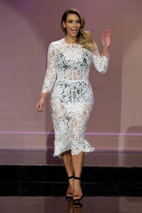 We love this look on Kardashian - Dolce & Gabbana's figure-hugging dresses were <em>made</em> for curves like Kim's.