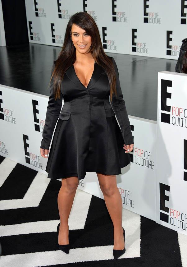 At seven months pregnant, Kardashian chose a simple and elegant Christian Dior coat dress while attending the E! 2013 Upfront event on April 22, 2013.
