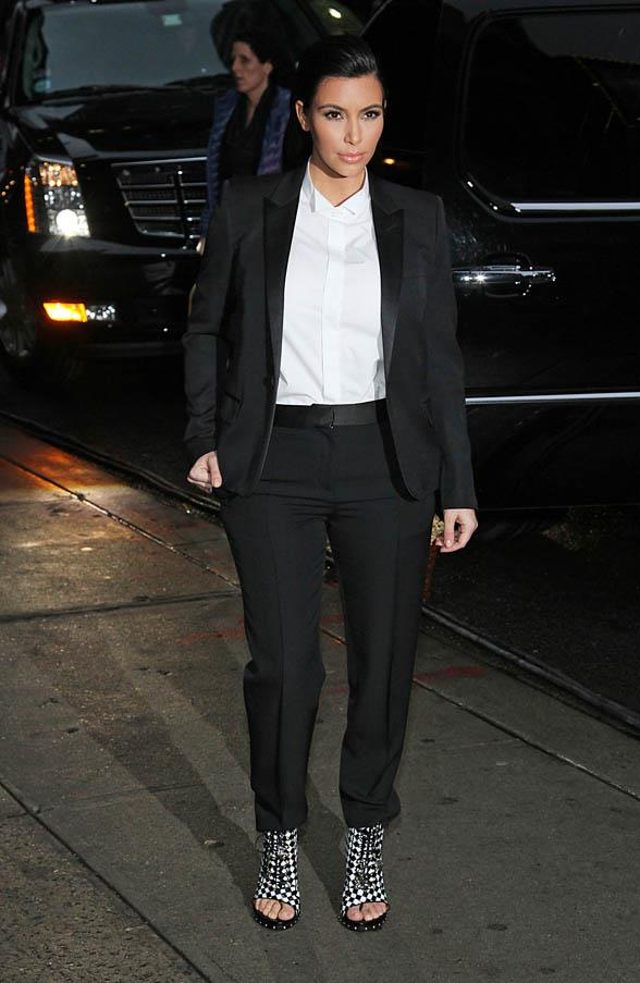 Baby bump discreetly hidden in an androgynous tailored black suit, white shirt combination as she visited the Letterman show in January 2013.