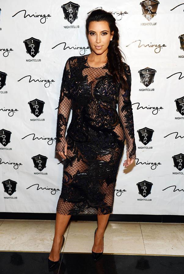 In sheer black lace dress at the 2013 New Year's eve countdown at 1 OAK Nightclub at the Mirage Hotel in Vegas - the same night that she and Kanye officially announced her pregnancy.