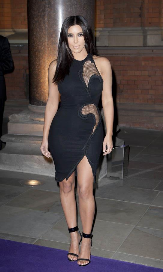In a fitted Stella McCartney dress featuring sheer panels at an event in London in 2012.