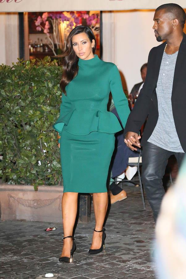 Walking the streets of Rome with Kanye, wearing a highly structured green peplum dress.