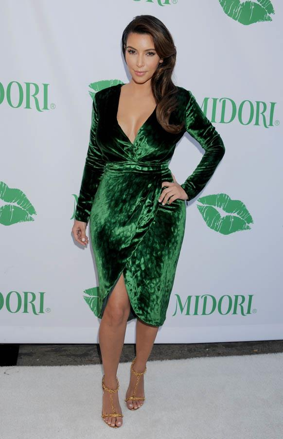 Coordinating with the theme in a green velvet dress at a Midori event in September 2012.