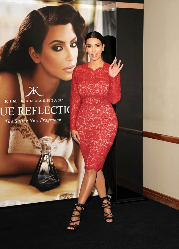 In a form-fitting red lace dress at the launch of her new fragrance in London in May 2012.