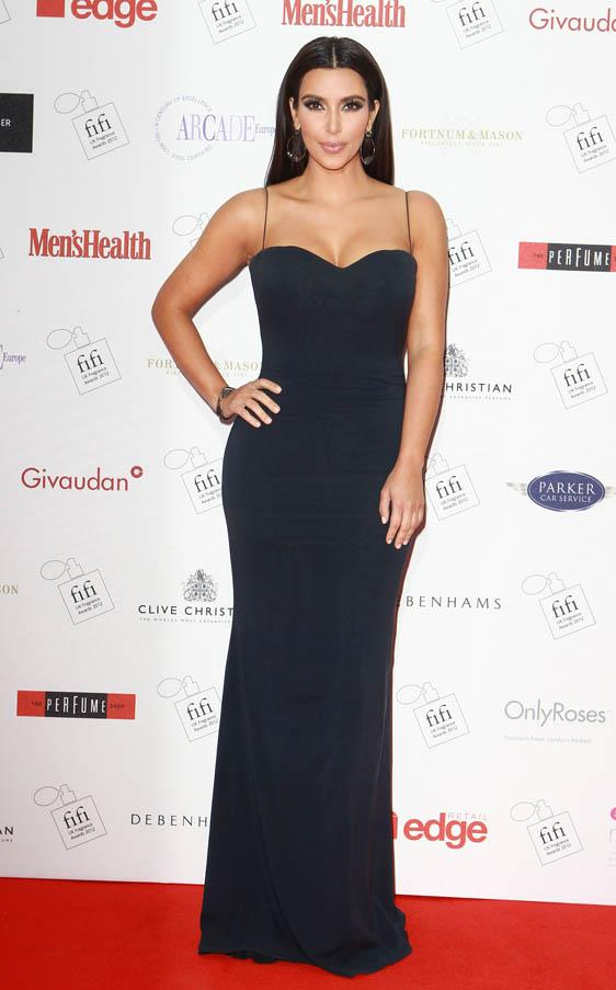 In a fitted black Marchesa gown at the FIFI UK fragance Awards in London in May 2012.