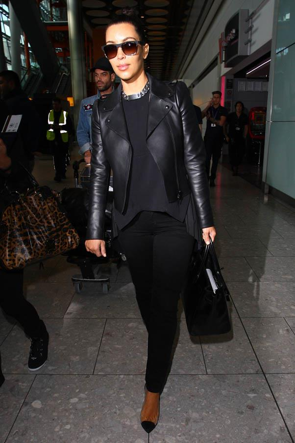 Travelling in style: at Heathrow airport in London in May 2012 in an all-black ensemble including a sleek leather jacket and over-sized sunglasses.