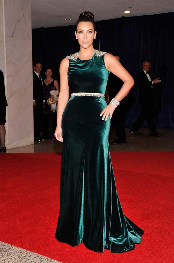 Attending the 2012 White House Correspondents dinner wearing a green velvet gown by Johanna Johnson.