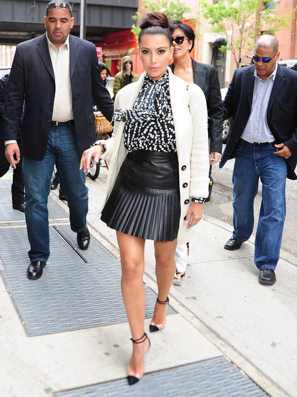 In a leather mini and white blazer on the streets of Manhattan in April 2012.