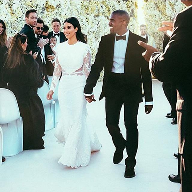 Marrying Kanye West in custom Givenchy on May 24.