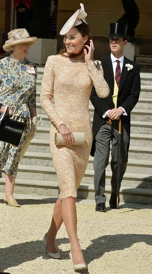 Kate Middleton wears a lace McQueen dress to a Garden Party at Buckingham Palace on June 10.