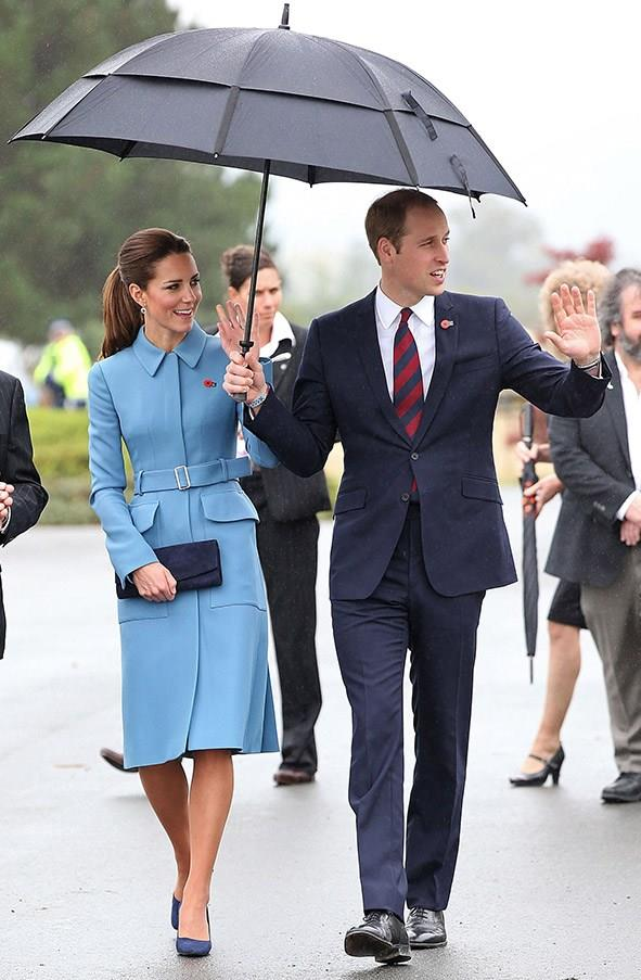 In an Alexander McQueen sky blue coat on the royal tour of Australia and New Zealand.