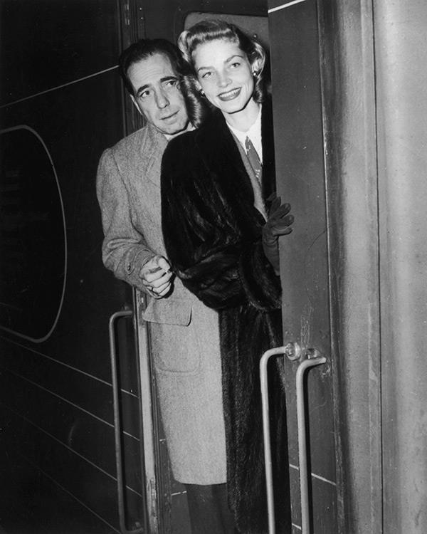 """Find me a man who's interesting enough to have dinner with and I'll be happy."" <br><br><em>With husband Humphrey Bogart in 1957.</em>"