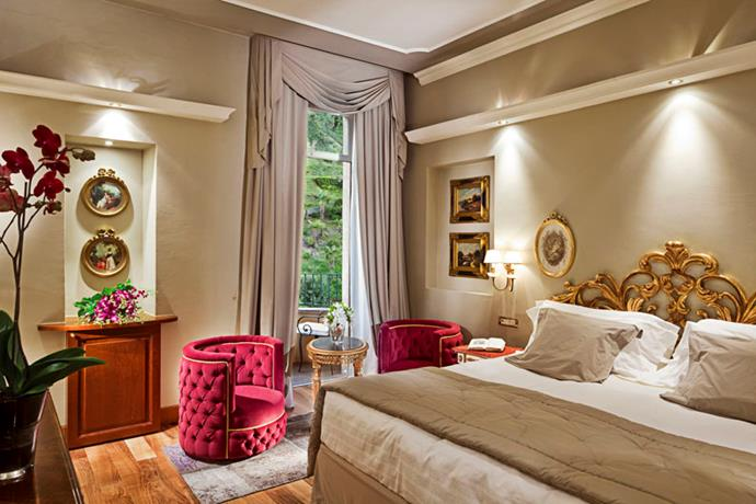 "<strong><a href=""http://www.grandhoteltremezzo.com"">Grand Hotel Tremezzo</a>, Lake Como</strong> <br><br>Of course, if you're feeling the need for a little passeggiata, then the hotel's chatelaine, Valentina de Santis, will be happy to arrange a trip to the nearby historical Villa del Balbianello (well worth a visit) and a table at Il Gatto Nero (The Black Cat) where Signor Clooney is a regular ... not that we'd go there just for that, of course. <br><em>- Jamie Huckbody</em> <br><br><a href=""http://www.grandhoteltremezzo.com/"">grandhoteltremezzo.com</a>"