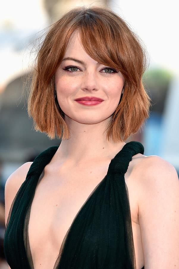Emma Stone debuted her new chop at the Venice Film Festival this week.