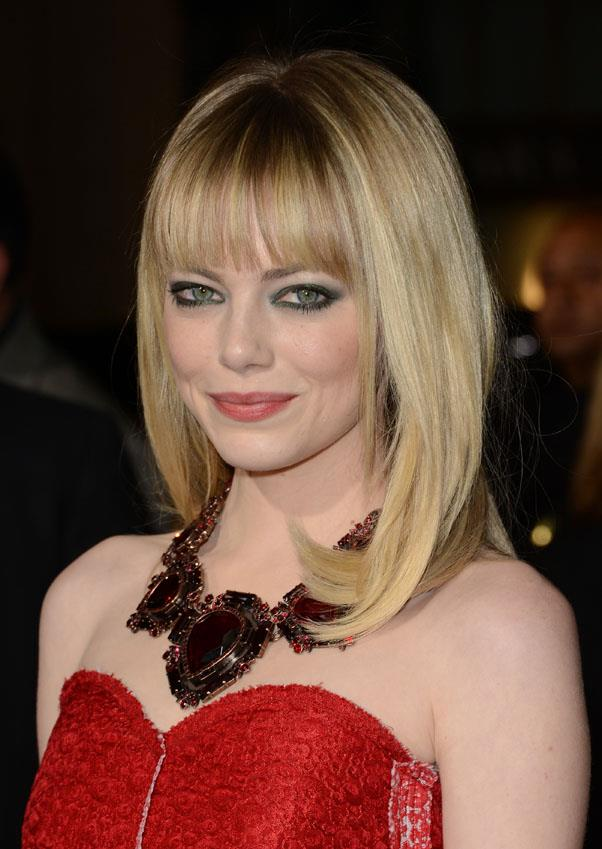 In January 2013, Stone swapped her sweeping side fringe for a blunt straight fringe.