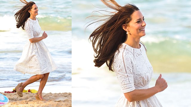 Kate running across the sand in her high-heeled wedges.