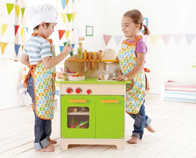 WHAT THEY'RE INTO... • Dramatic play like dress-ups with complex storylines • Messy play with paints, water, sand and mud • Physical play that tests balance, climbing ability and coordination  • Simple board games that teach turn-taking, rules and counting • Songs, books, silly rhymes that bring out their sense of humour My Giant Kitchen @ Eco Toys
