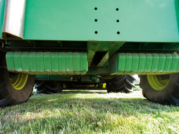 Counterweights are neatly concealed under the machine to provide ballast, particularly useful for heavy maize headers