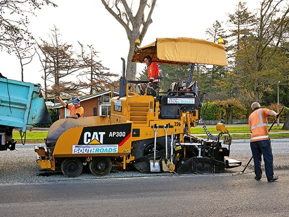 The Cat AP300 asphalt paver in action. The machine has increased on-site productivity.