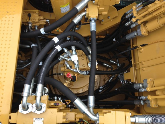 A view into the Cat 336EH's engine compartment, showing the Adaptive Control System (ACS) valve.