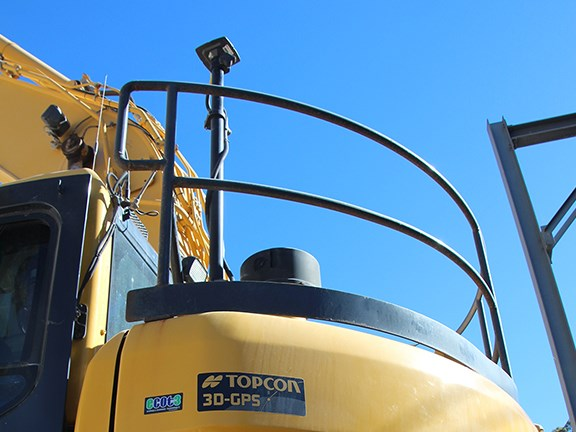 Part of Topcon's 3D GPS X-63i excavator system is seen mounted on the PC-228.
