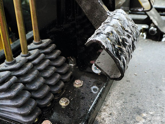 The high-set brake pedal is one of the few negatives of the NorAm 65E grader.