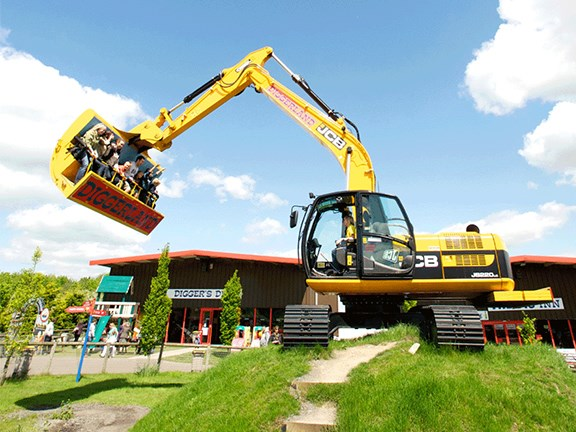 Don't try this at home: Patrons get a ride in the 'bucket' of a JCB JS220 LC excavator at a Diggerland park in the UK.
